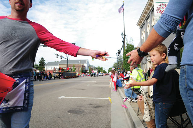 The 60th annual Mum Festival kicked off last Saturday morning with a parade. Local organizations handed out candy to youngsters along the parade route.