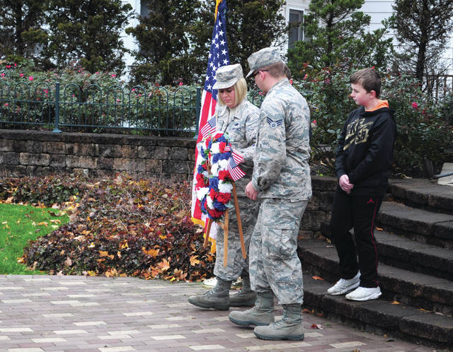 Cecilia Fox | Weekly Record Herald Mast. Sgt. Angela Potchik and her son Senior Airman Jacob Burritt placed a wreath a the veterans memorial in Tipp City on Friday, Nov. 9.