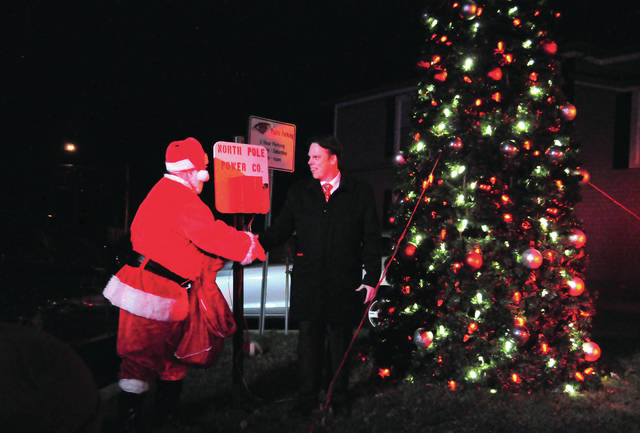 Cecilia Fox | Weekly Record Herald Santa and Vice Mayor Scott Hurst flipped the switch to light the downtown West Milton Christmas tree on Saturday, Nov. 17.