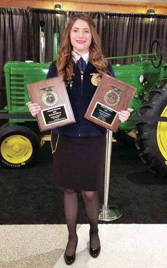provided photo Milton-Union grad Abigail Hissong displays the awards she received at the 2018 National FFA Convention. Hissong was earned a National Proficiency award in Agriscience Research.