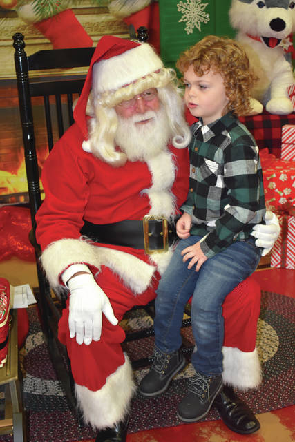 Provided photo Camden Fisher enjoyed meeting Santa during the annual Tipp Monroe Community Services Visit with Santa event on Dec. 1. More than 250 children and their families came to see Santa at Broadway Elementary School. Each child sat on Santa's lap, told him their Christmas lists, had their picture taken, and received a candy cane. Parents and children were treated to cookies, doughnut holes, and milk. Provided photo Madison Piel was the winner of the Tipp Monroe Community Services Visit With Santa door prize. She won a very large stuffed husky puppy.