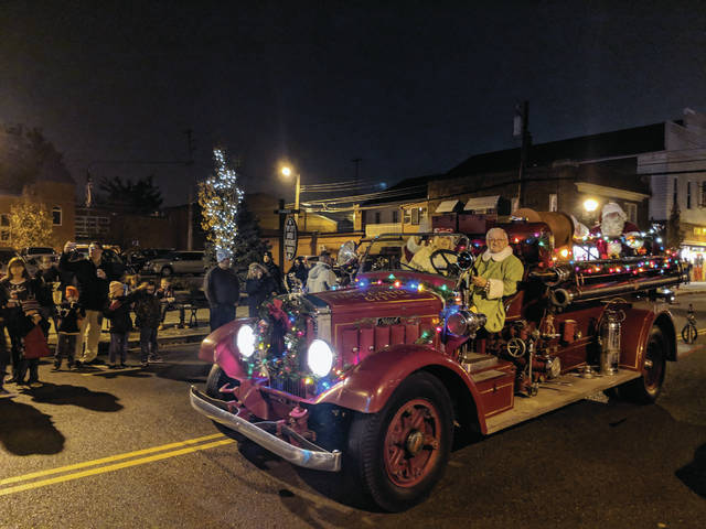 Cecilia Fox | Weekly Record Herald Santa arrived to the Tipp City tree lighting, not in his sleigh, but in the city's antique fire truck.