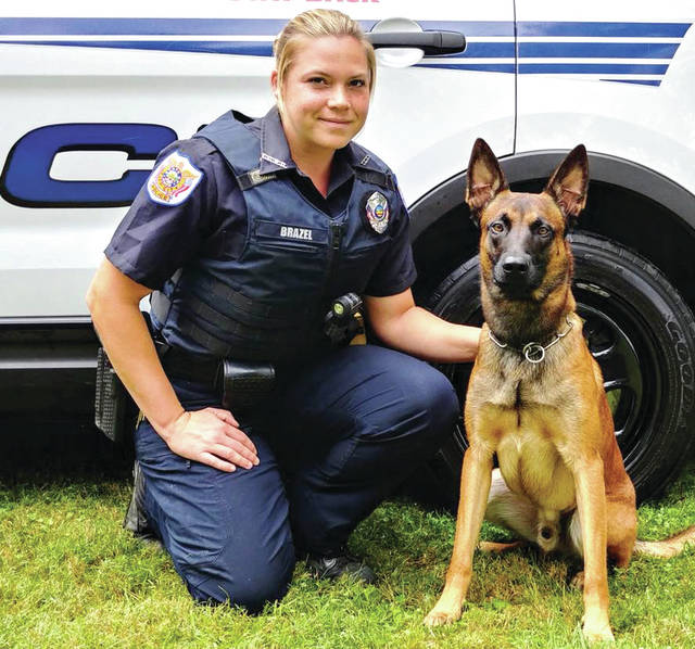 Provided photo Tipp City K-9 Pasha is handled by Officer Parrish Brazel. A fundraiser to buy new training gear for Pasha is scheduled for Saturday.