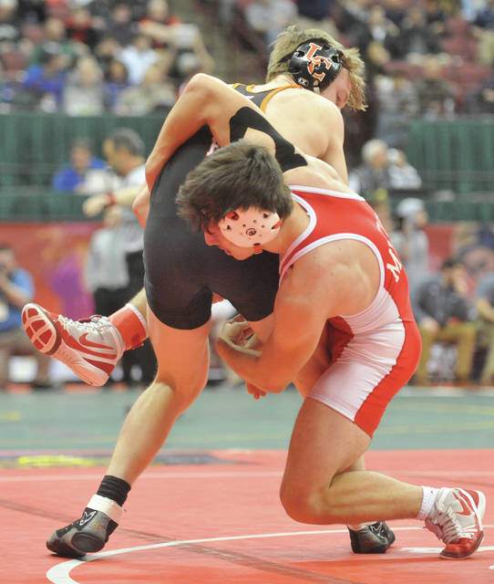 Josh Brown|Miami Valley Today Milton-Union's Dylan Schenck grapples with Liberty Center's Tyler Kay in a first-round match at the Division III state tournament Thursday at the Schottenstein Center.