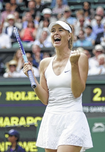 AP photo Maria Sharapova celebrates winning her singles match Tuesday against Coco Vandeweghe at the All England Lawn Tennis Championships in Wimbledon, London.