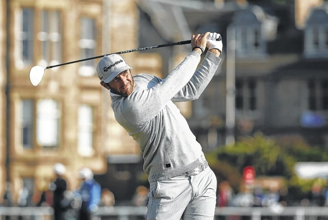 AP photo Dustin Johnson drives the ball from the second tee Friday during the second round of the British Openat the Old Course, St. Andrews, Scotland.