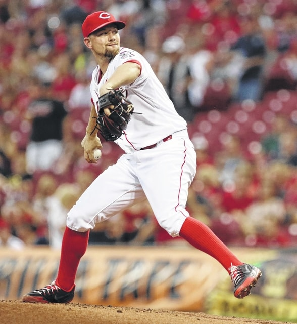AP photo Reds starting pitcher Mike Leake throws against Cleveland during Friday's game in Cincinnati.