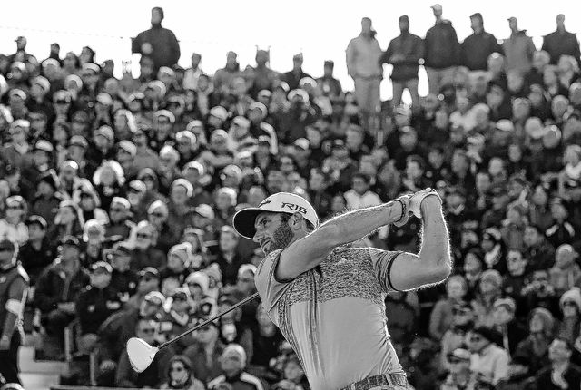 AP photo Dustin Johnson drives a ball from the 17th tee Saturday during the second round of the British Openat the Old Course, St. Andrews, Scotland.