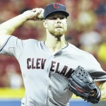 Indians even series with Reds
