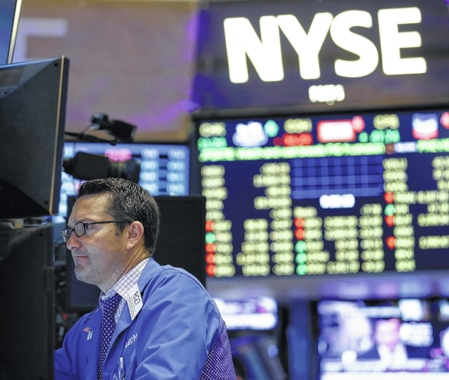 Traders work on the floor at the New York Stock Exchange in New York on Wednesday. (AP Photo/Seth Wenig)