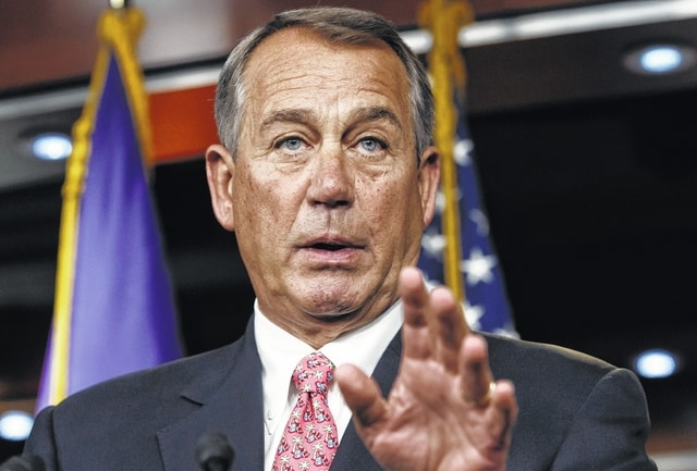 In this Dec. 11 file photo, House Speaker John Boehner of Ohio speaks during a news conference on Capitol Hill in Washington. (AP Photo/J. Scott Applewhite, File)