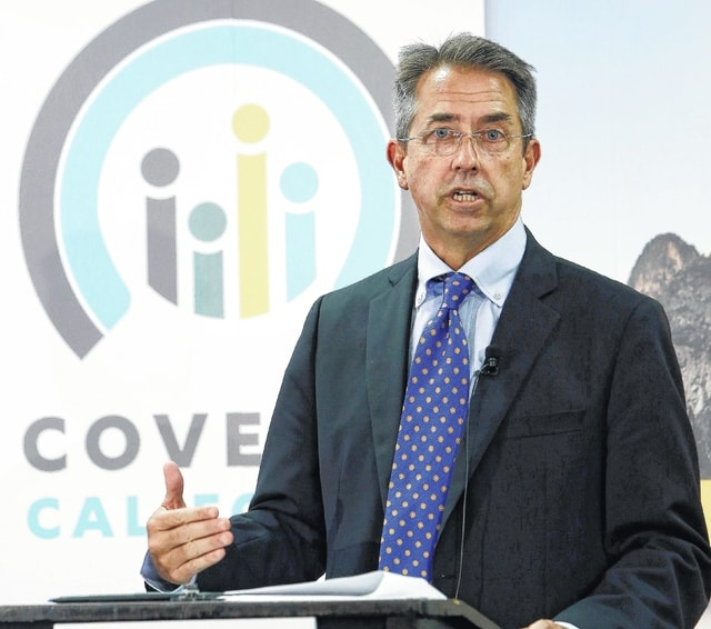 """In this Nov. 13, 2013, file photo, Peter Lee, executive director of Covered California, the state's health insurance exchange, announced that nearly 35,000 people signed up for health insurance during the first month of open enrollment, from Oct. 1 through Nov. 2, 2013, during a news conference in Sacramento, Calif. State-run health insurance markets that offer taxpayer-subsidized coverage under President Barack Obama's law are grappling with high costs and disappointing enrollment, challenges that could lead more of them to turn over functions to the federal government, or join forces with other states. With the pressure gone, """"I think you are going to see a much more of a hybrid across the nation,' said Lee. (AP Photo/Rich Pedroncelli, File)"""