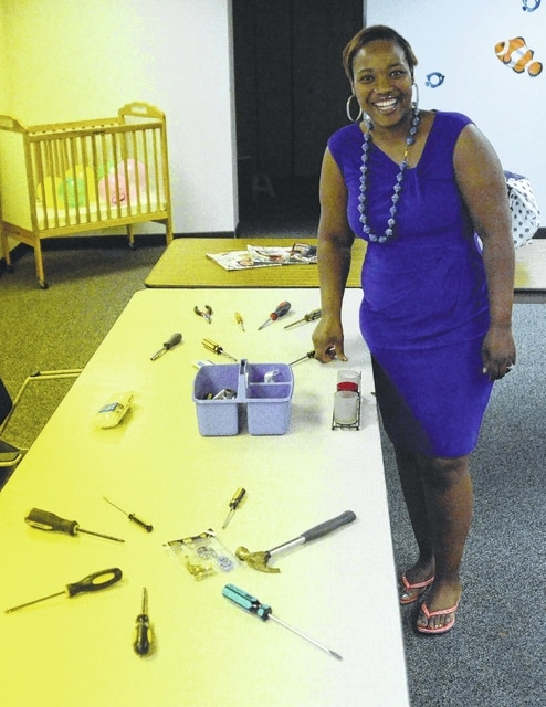 Greg Sowinski | The Lima News Cortesha Cowan returned to her hometown Friday for the grand opening of the Lima Empowerment Center to help young, at-risk women.