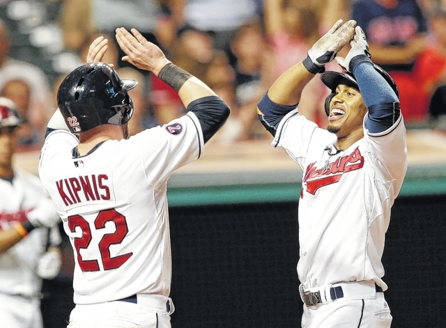 Cleveland Indians' Francisco Lindor, right, celebrates with Jason Kipnis after Lindor hit a three-run home run in the seventh inning, Monday, in Cleveland. AP Photo