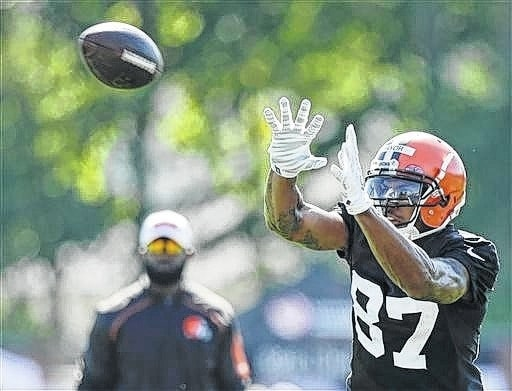 Cleveland Browns wide receiver Terrelle Pryor catches a pass during practice at the team's training camp Thursday, in Berea. Pryor has been a quarterback his entire football life, but is swtiching positions at the highest level, trying to win a roster spot as a wide receiver. AP Photo