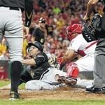 Pirates' bullpen holds off Reds 5-4