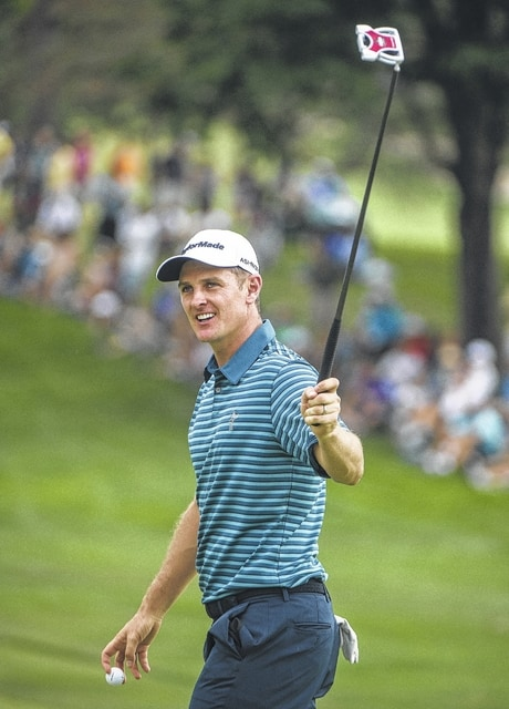 AP photo Justin Rose, of England, reacts after making a birdie on the 18th hole Saturday during the third round of the Bridgestone Invitational in Akron.