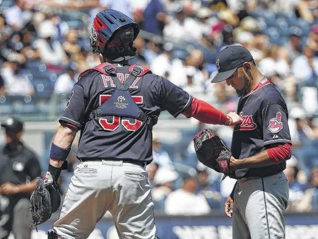 AP photo Cleveland catcher Roberto Perez (55) encourages pitcher Danny Salazar after Salazar gave up a second home run to the Yankees during the first inning of Saturday's game in New York.