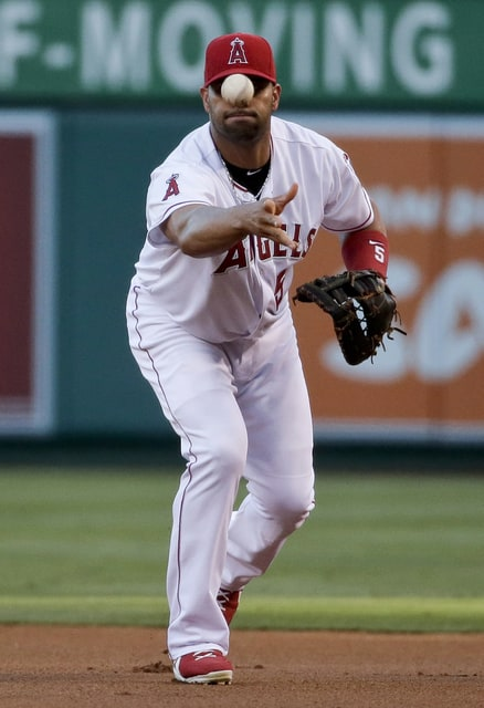 Los Angeles Angels first baseman Albert Pujols throws out Cleveland Indians' Francisco Lindor at first during the first inning of a baseball game in Anaheim, Calif., Tuesday, Aug. 4, 2015. (AP Photo/Chris Carlson)