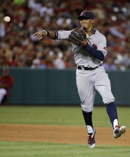 Cleveland Indians shortstop Francisco Lindor throws out Los Angeles Angels' Conor Gillaspie at first during the eighth inning of a baseball game in Anaheim, Calif., Tuesday, Aug. 4, 2015. (AP Photo/Chris Carlson)