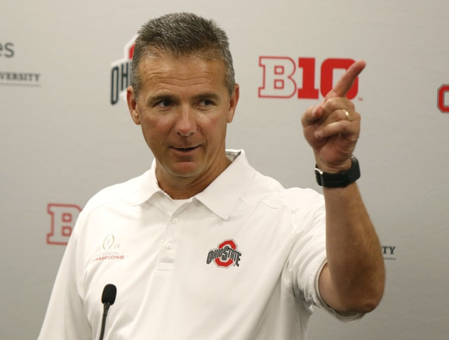FILE - In this Aug. 16, 2015, file photo, Ohio State coach Urban Meyer speaks to reporters during the university's NCAA college football media day in Columbus, Ohio. Ohio State is the first unanimous preseason No. 1 in The Associated Press college football poll. (AP Photo/Paul Vernon, File)