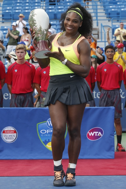 Serena Williams. pf the United States, holds the Rookwood Cup after defeating Simona Halep, of Romania, in the women's final at the Western & Southern Open tennis tournament, Sunday, Aug. 23, 2015, in Mason, Ohio. (AP Photo/John Minchillo)