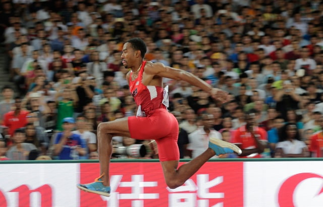 United States' Christian Taylor competes in the men's triple jump final at the  World Athletics Championships at the Bird's Nest stadium in Beijing, Thursday, Aug. 27, 2015. (AP Photo/Andy Wong)