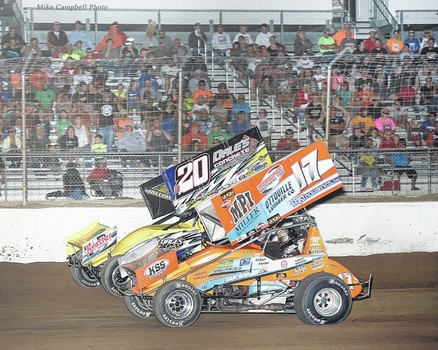 Special to The Lima News Jared Horstman (17) and Butch Schroeder battle for the lead Friday night during the Sprint feature at Limaland Motorsports Park.