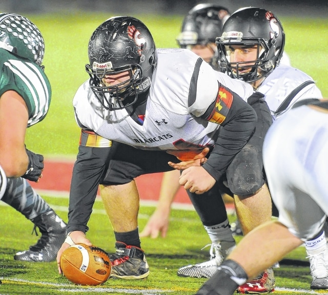 Spencerville center Evan Barnett hikes the ball to Mason Nourse during last year's playoff game against Tinora. The Bearcats have 16 starters back from last year's team that went 9-3, with expectations they'll compete for the Northwest Conference title.