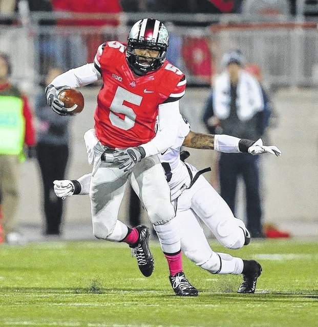 Ohio State's Braxton Miller (5) runs the football in a game against Penn State at Ohio Stadium in 2013. DON SPECK/The Lima News