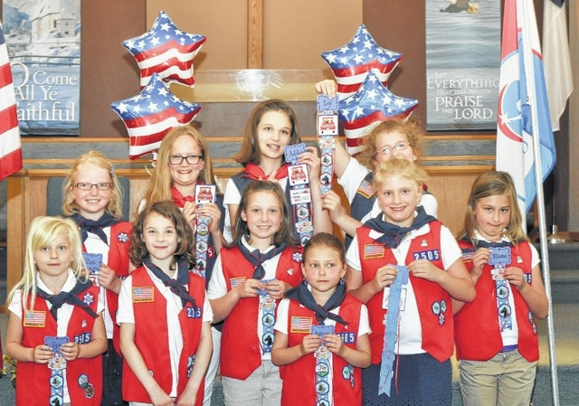 Troop OH2505 at their end of the year awards ceremony. The girls are holding up their badges they earned during the last half of the year.