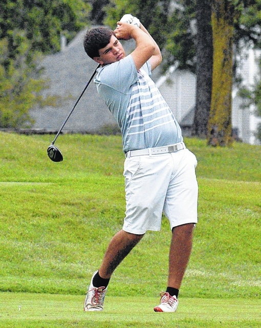 Dean Brown | The Lima News Lima Central Catholic's Ian Friesner watches his shot from the fairway during a match against Kalida and Elida at Country Acres on Wednesday.