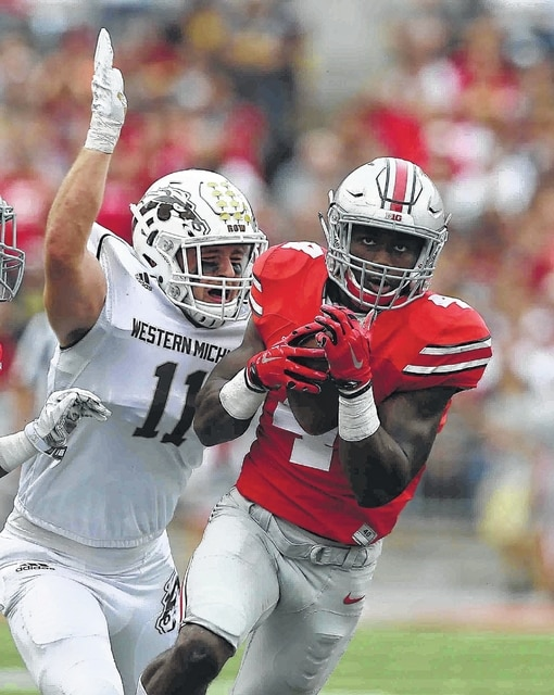 Don Speck | The Lima News Ohio State's Curtis Sammuel Hauls in a pass against Western Michigan's Austin Lewis during Saturday's game at Ohio Stadium in Columbus.