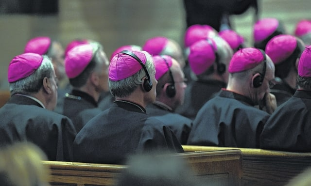 Bishops listen to Pope Francis during the midday prayer from the Liturgy of Hours, the daily form of prayer of the Catholic Church, with bishops from the U.S. on Wednesday at the Cathedral of St. Matthew the Apostle in Washington. (AP Photo/Susan Walsh)
