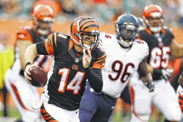 Bengals quarterback Andy Dalton runs for yardage in an exhibition game against the Chicago Bears in Cincinnati. AP photo