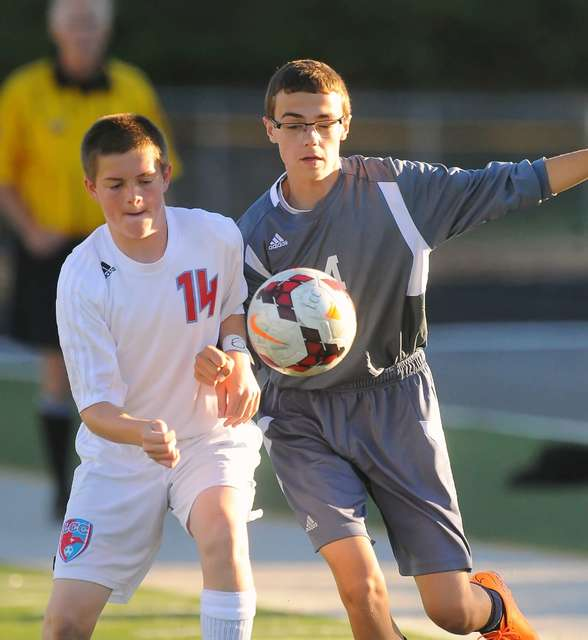 Richard Parrish   The Lima News Trey Horstman of Lima Central Catholic, left, competes for the ball with Dawson Draper of Temple Christian during Thursday's match at Spartan Stadium.