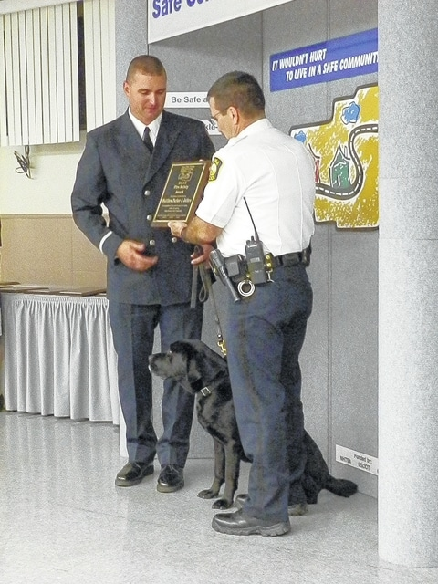 Craig Kelly | The Lima News Matthew Parker of the Lima Fire Department was honored with his dog, Jethro, a bomb-sniffing dog, during the Lima-Allen County Safe Community Coalition's Safe Community Awards Thursday at the Lima FOP Hall.