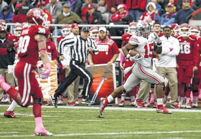 AP photo Ohio State's Ezekiel Elliott runs 55 yards for a touchdown during Saturday's game against Indiana in Bloomington, Ind.