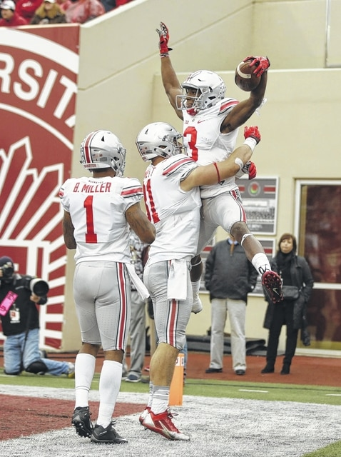 AP photo Ohio State's Michael Thomas (3) celebrates with Nick Vannett (81) and Braxton Miller (1) after Thomas caught a 23-yard touchdown pass during Saturday's game against Indiana in Bloomington, Ind.
