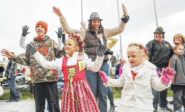 Adults and children alike enjoy dancing to the German polka band Sorgenbrecher at the gazebo during the 40th annual Minster Oktoberfest on Sunday afternoon.