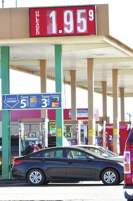 Craig J. Orosz | The Lima News A customer pumps gas at Wal-Mart on Harding Highway in Lima on Monday morning. Unleaded was as low as $1.95 per gallon.