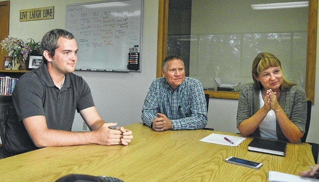 """Whirlpool associates, left to right, Patrick Feltman, Al Inkrott and Jenni Hanna discuss what they do at Whirlpool Corporation in Ottawa and the future of the plant. The company started its """"Project Alaska"""" line in September, bringing more energy efficient freezers to production."""