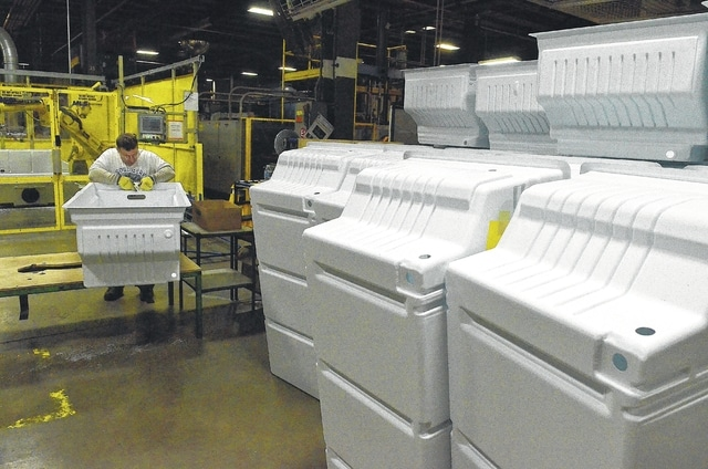 Whirlpool associate Bruce Dunn, works on a food liner in the plastic department at Whirlpool Corporation in Ottawa. The liners are for upright freezers. The company builds upright and chest freezers under the Whirlpool, Amana and Maytag names.