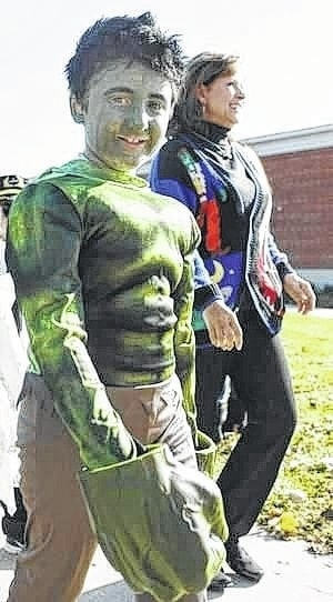 Linda Hoersten | Submitted photo A Perry Elementary School student dressed as the Incredible Hulk walks in last year's Halloween parade.