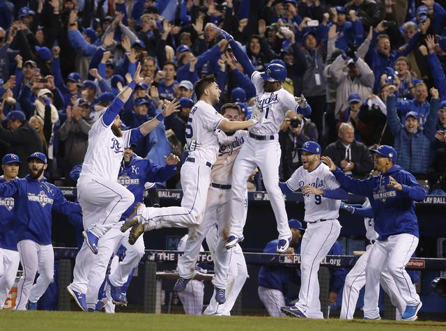 AP photo Royals players celebrate after Alcides Escobar scored the winning run on a sacrifice fly by Eric Hosmer during the 14th inning of Game 1 of the World Series against the New York Mets early Wednesday in Kansas City, Mo.
