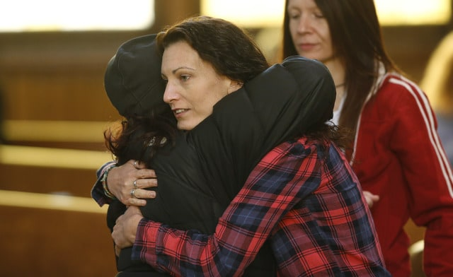 Unidentified women hug at a vigil inside a church to mark Friday's shooting at a Planned Parenthood clinic Saturday in Colorado Springs, Colo. (AP Photo/David Zalubowski)