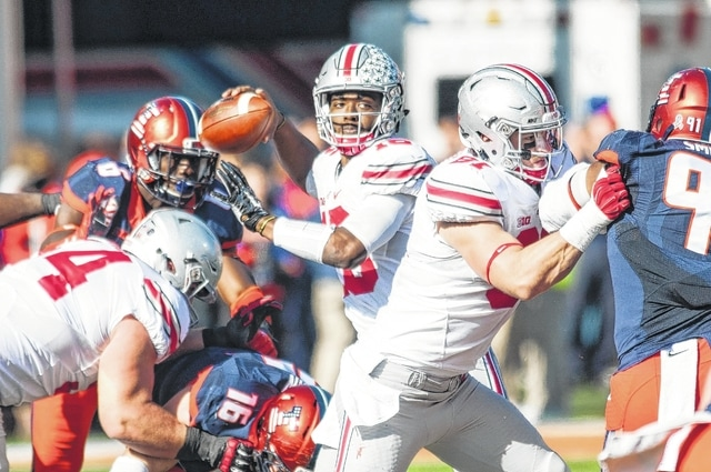 AP photo Ohio State quarterback J.T. Barrett (16) passes the ball during Saturday's game against Illinois at Memorial Stadium in Champaign, Ill.