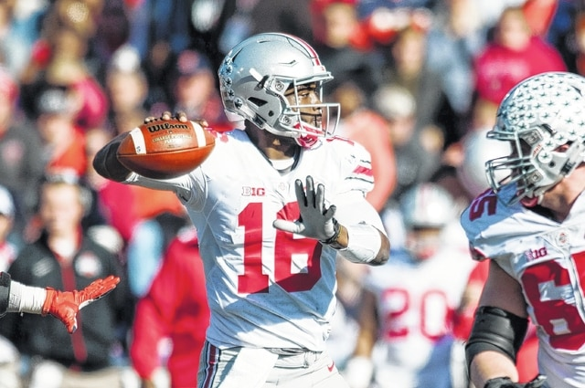 AP photo J.T. Barrett (16) threw for 300 yards and three touchdowns and rushed for two more in Ohio State's 49-37 win at Michigan State in 2014.