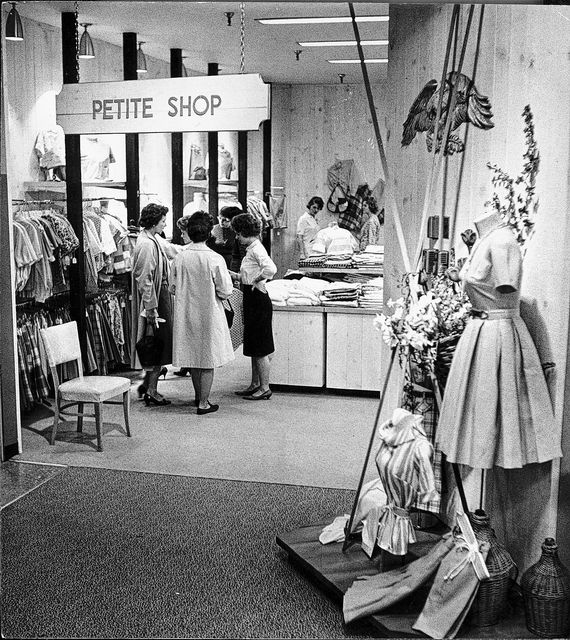 Women browse in the Petite Shop inside the Leader in 1962.