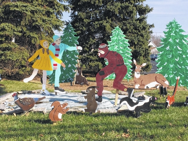 Various folk art displays decorate downtown Bluffton for the Blaze of Lights, a long-standing annual tradition.